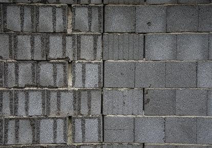 Lavori di ristrutturazione e muri perimetrali in cemento armato: perché la spesa deve essere ripartita tra tutti i condomini?