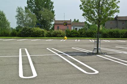 Area destinata a parcheggio. Le Sezioni Unite risolvono il problema del litisconsorzio necessario.
